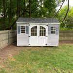 White vinyl siding shed in Long Island NY.
